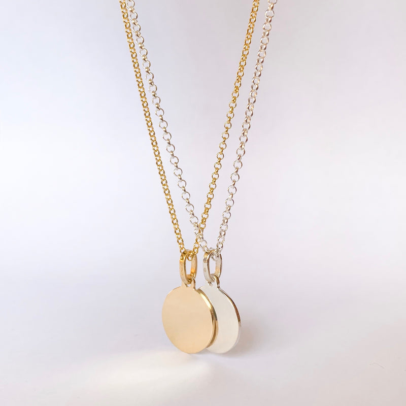 gold and silver necklaces with rolo chain and round pendant