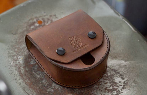 Leather fly fishing reel holder from Dead Miners Handmade Goods, Keweenaw Peninsula, Michigan