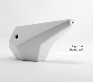 The PRISM ceramic hand pipe lays flat and stands tall. A flat bottom and balanced design lets the pipe sit still on a flat surface with the bowl on top, the pipe also has a finger hole on the left side of the bowl.