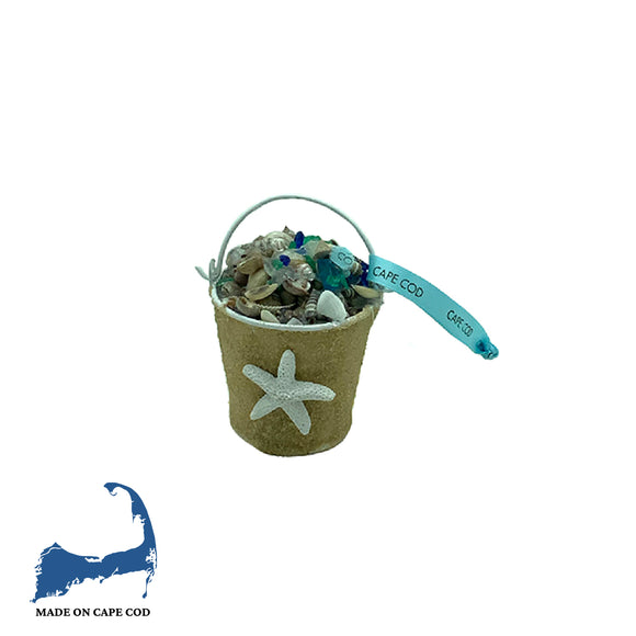 Beach Finds in Pail with Starfish