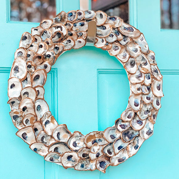 Gold Trimmed Oyster Shell Wreath with Navy Ribbon