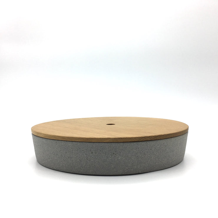 Part of the FS Collection, the FS BOX is a FS Cazuela with an hand-turned wooden lid. The hole in the center of the lid allows you to lift it easily with one finger. This versatile trinket box was originally designed to sit on desk or night stand, but it can be used anywhere in the house or office.