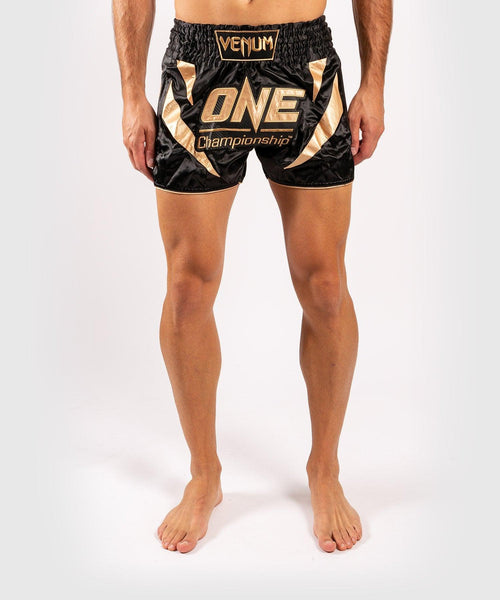 Venum x ONE FC Muay Thai Shorts - Black/Gold picture 1
