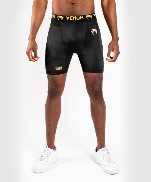 Venum G-Fit Compression Shorts – Black/Gold picture 1
