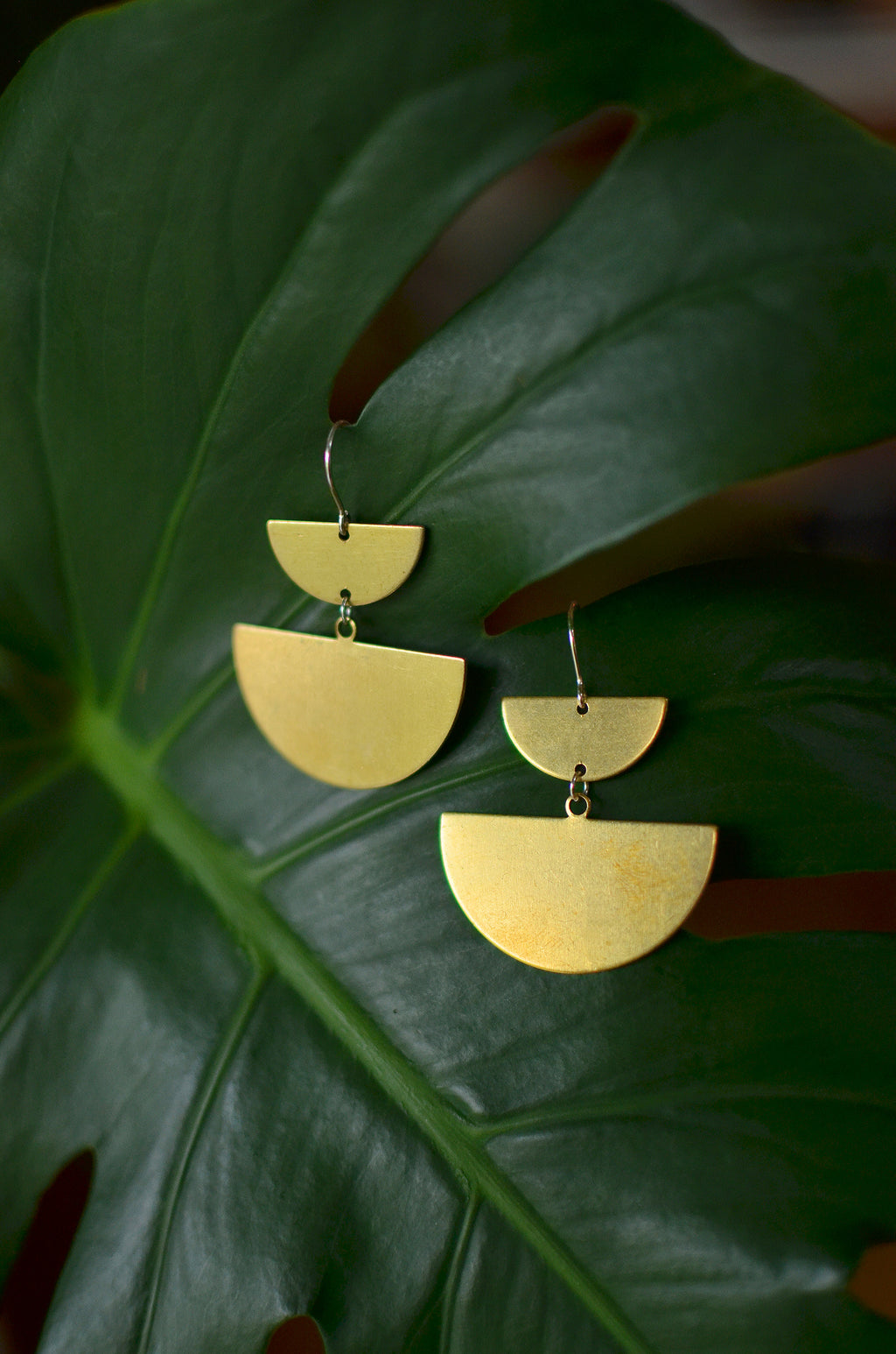desert queen. one pair large bold modern raw brass half moon dangle earrings.