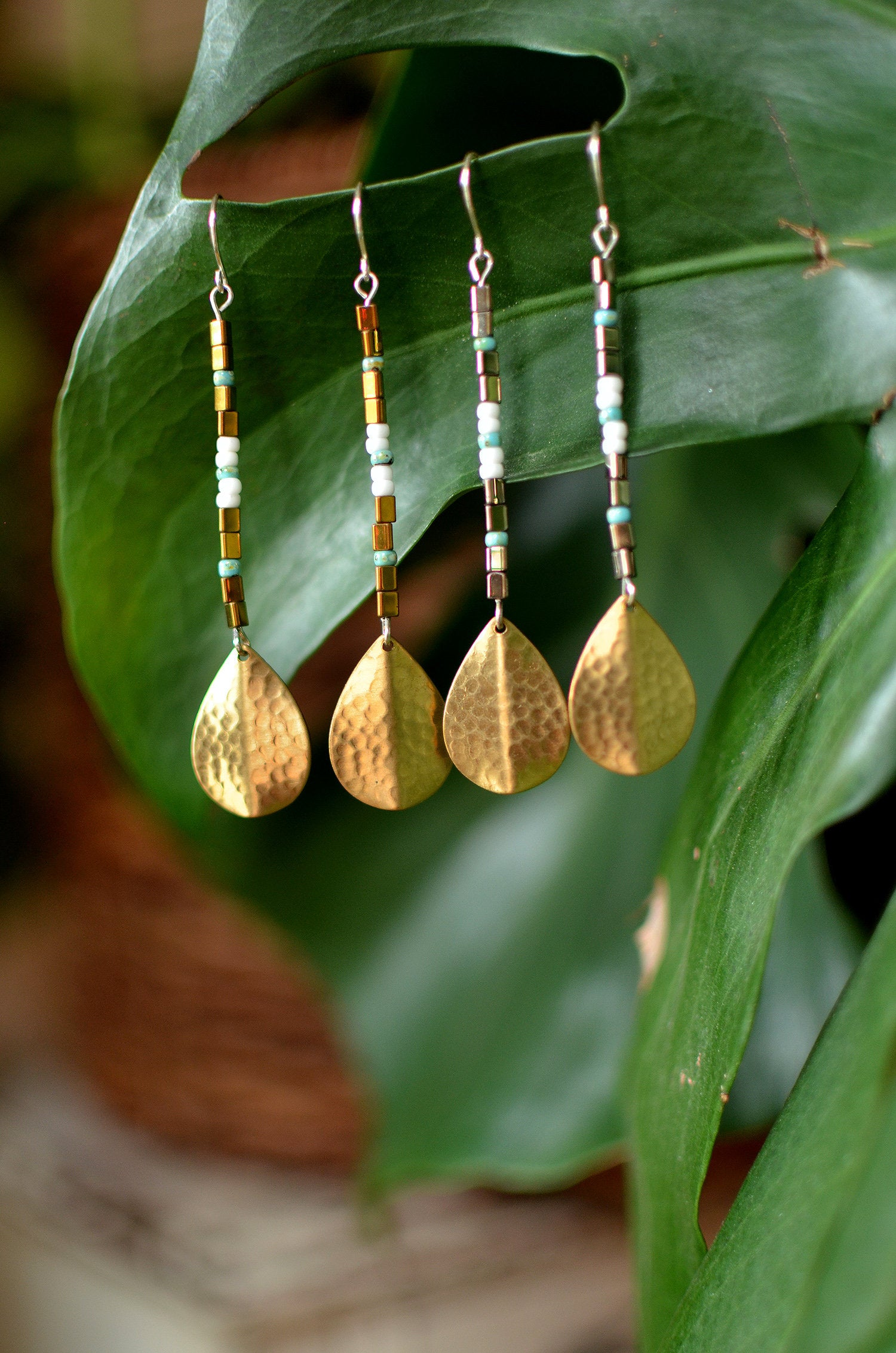 urban goddess. one pair seed bead and brass petal dangle earrings on sterling silver ear wires.