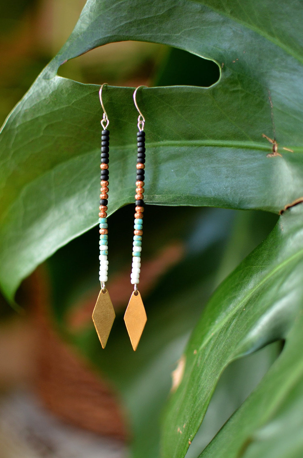 warrior woman. one pair seed bead dangle earrings on 14kt gold filled wires with spear points.