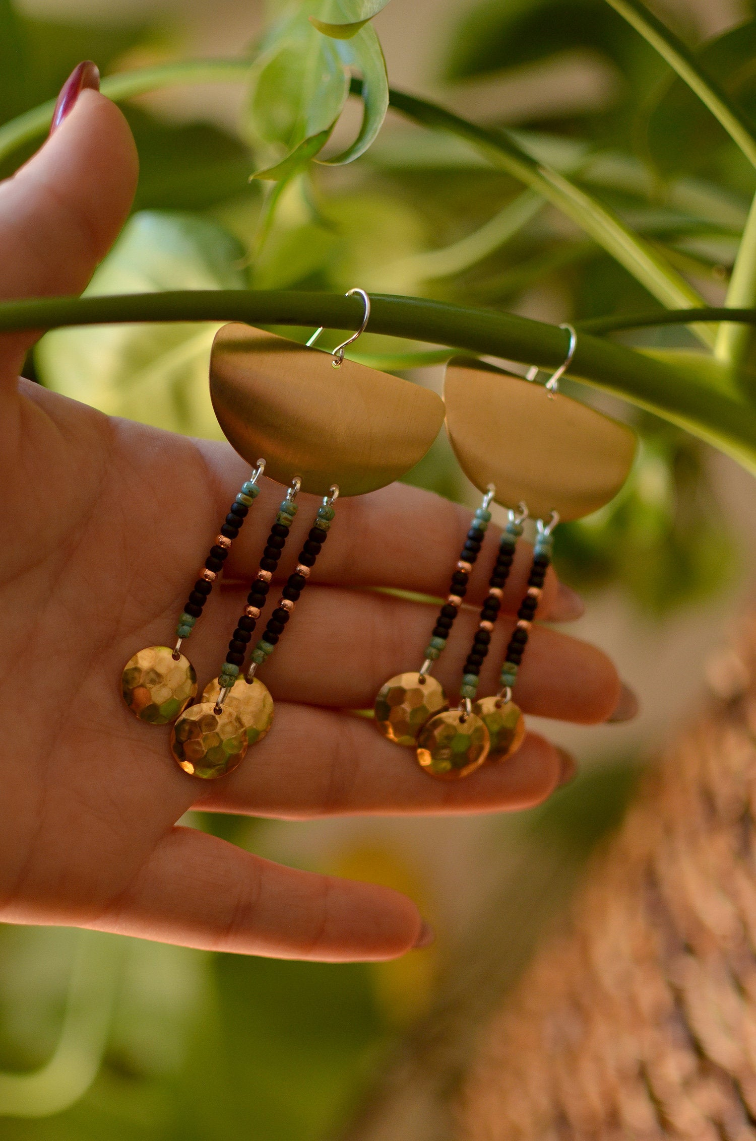 warrior woman. one pair raw brass shield earrings with seed beads & gleaming dapped brass circles.