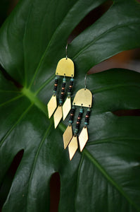 warrior woman. one pair raw brass arch earrings with seed bead dangles and brass arrow points.