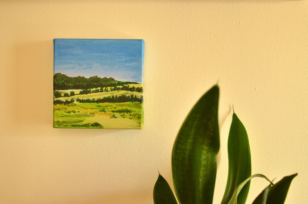 journey. an original landscape painting. countryside. rolling green hills. blue skies. travel.