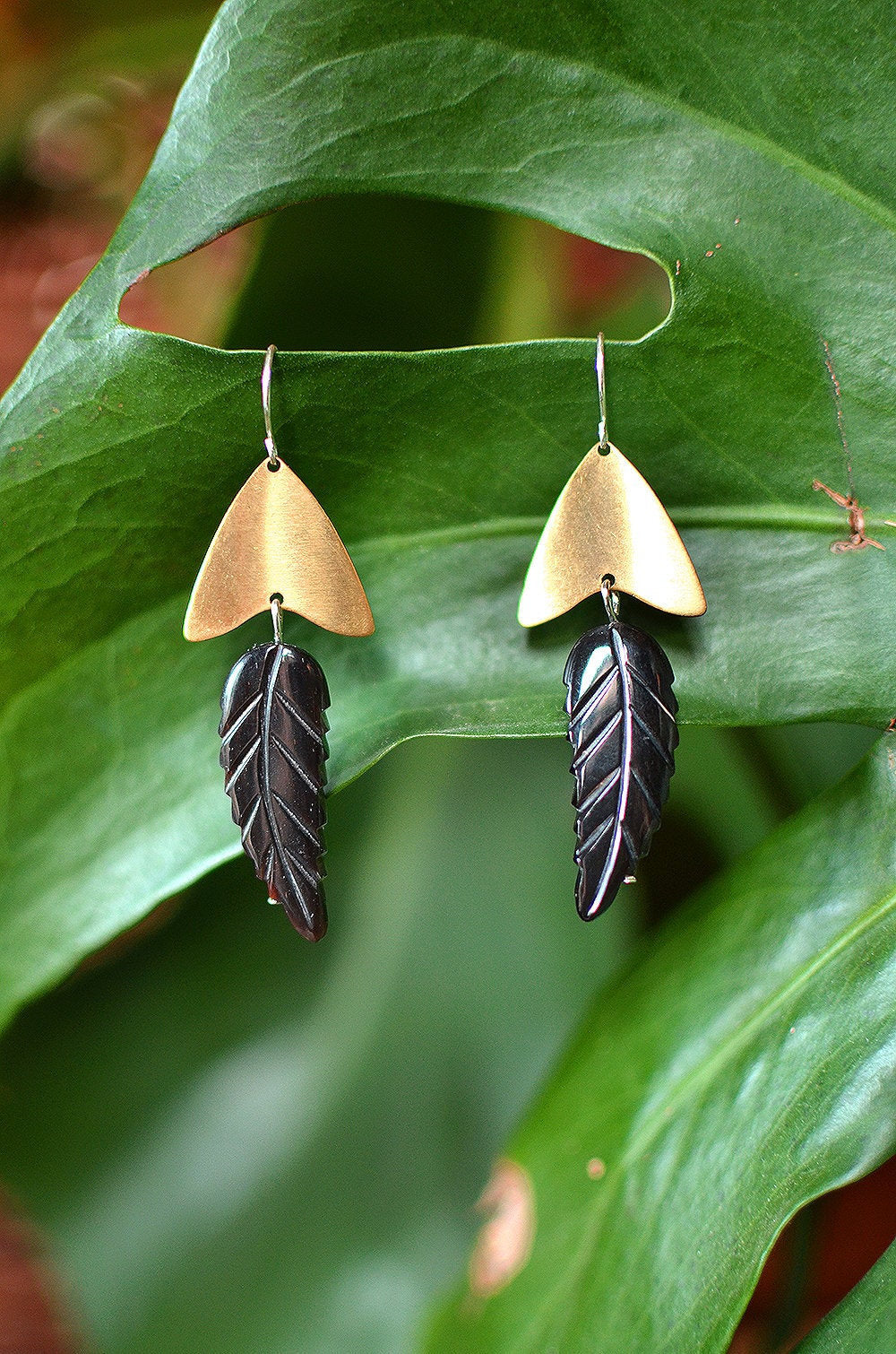 warrior woman. one pair modern brass chevron & carved black horn feather dangle earrings.