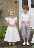 Pageboy and Bridesmaid in outfits by Amelia Brennan Weddings