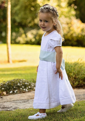 Bridesmaid wears Swiss Dot Cotton Flowergirl dress by Amelia Brennan Weddings