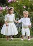 Pageboy and Bridesmaid wearing ivory silk and willow green sashes by Amelia Brennan Weddings