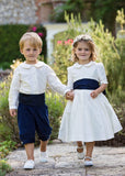 Bridesmaid and Pageboy in Navy themed outfits by Amelia Brennan Weddings