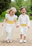 Pageboy and Bridesmaid wearing ivory silk and yellow sashes by Amelia Brennan Weddings