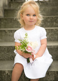 White cotton pintucked flowergirl dress by Amelia Brennan Weddings