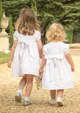 White cotton pintucked flowergirl dresses by Amelia Brennan Weddings