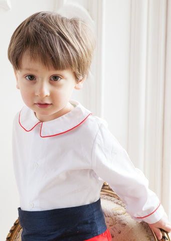 Amelia Brennan - Page Boy in white peter pan collar shirt with red piping