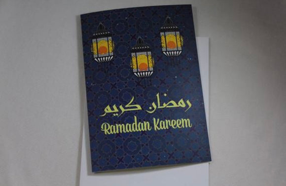 Ramadan Kareem greeting card with Arabic script and Moroccan background