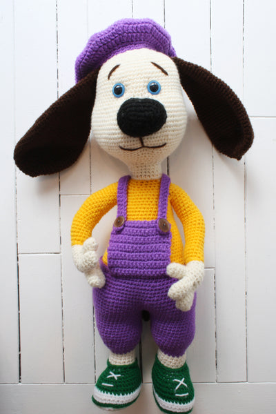 crocheted dog dressed as an artist
