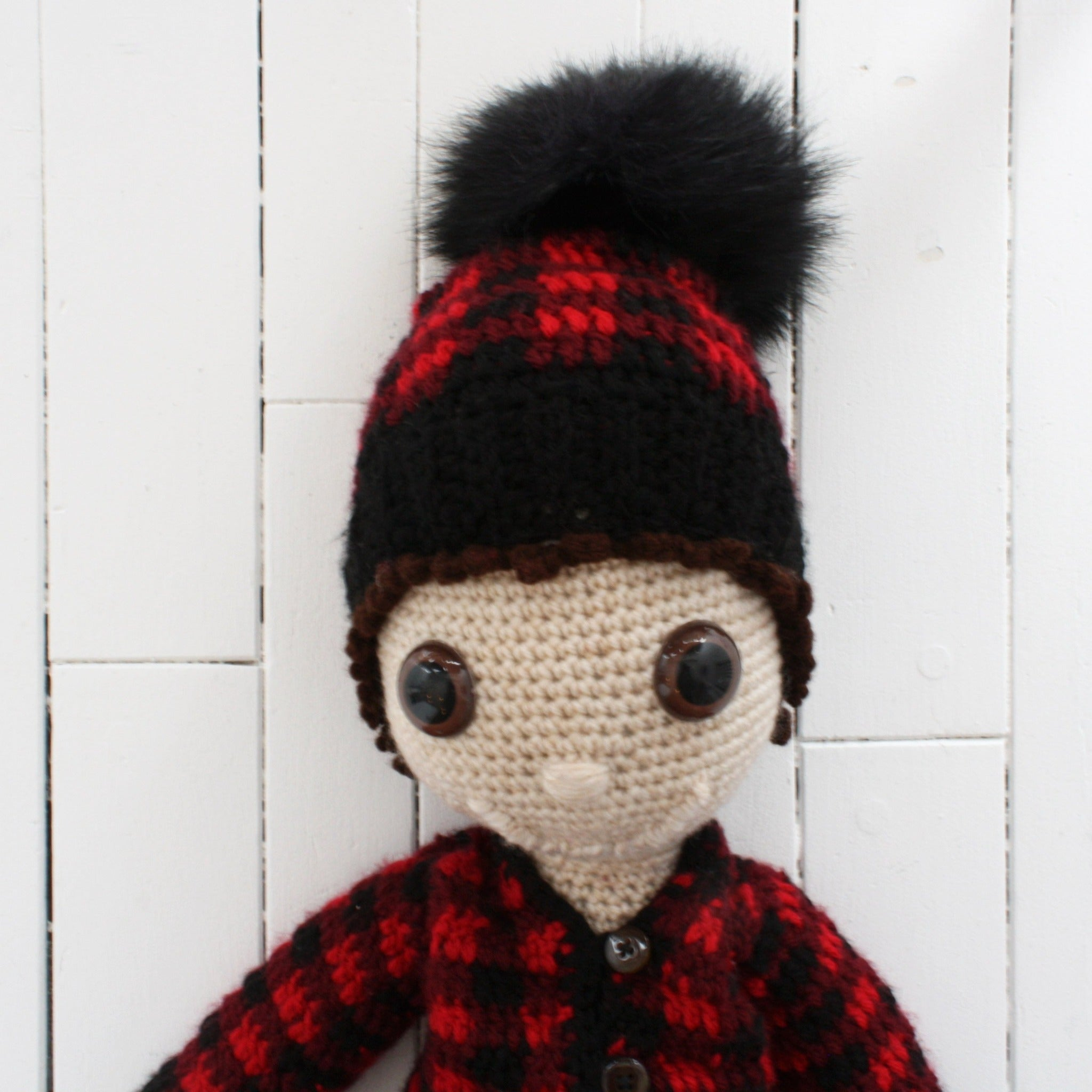 plush doll with winter hat and sweater