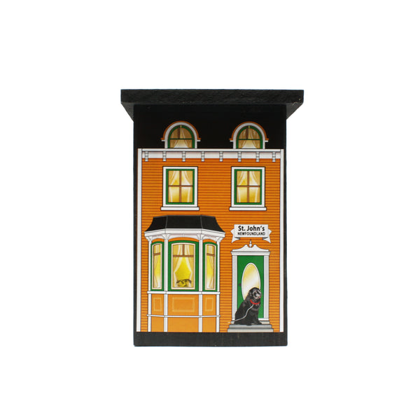 orange St. John's house with white trim and green door