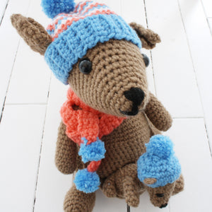crocheted kangaroo and joey with winter hat and scarf