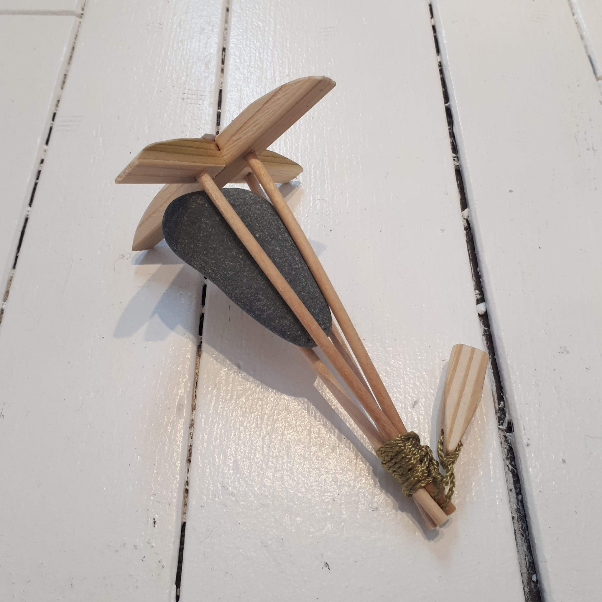 miniature killick with beach stone and wooden sticks