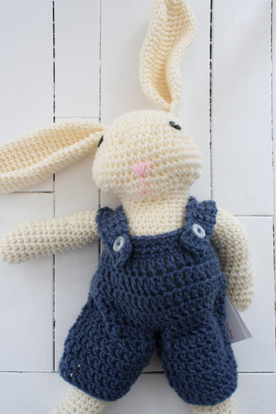 crocheted rabbit with blue overalls, button eyes, and big floppy ears