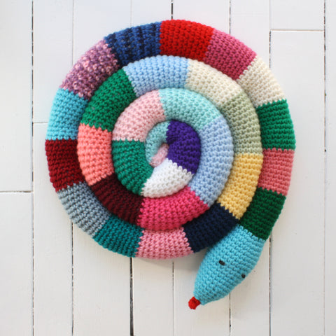 colourfully crocheted snake with wool eyes and tongue