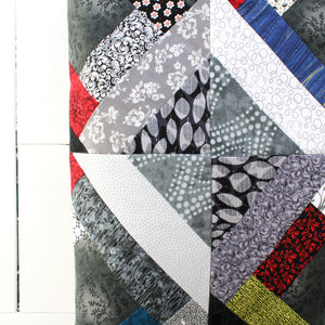 squares and stripes patchwork quilt with darker colors and patterns