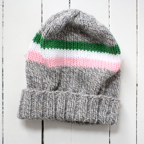 knitted toque with pink, white, and green stripes