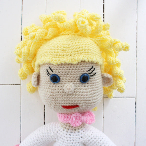 giant doll with yellow hair and blue eyes