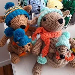 two handmade kangaroo with joeys in pouch dressed in winter hat and scarf