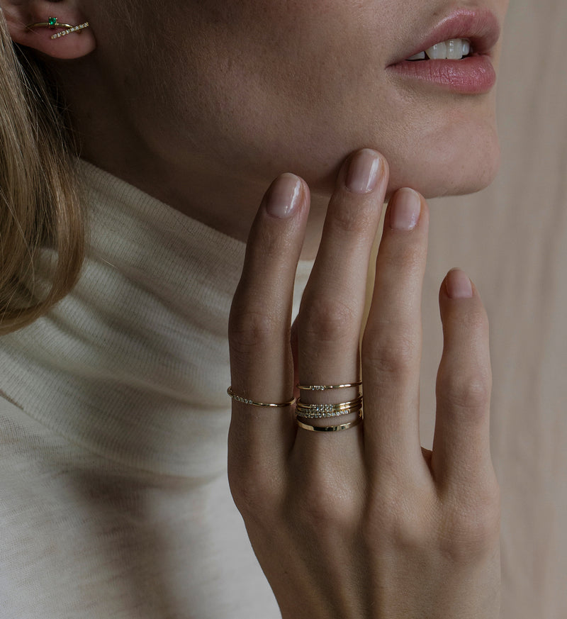 OUVERTURE, Fine jewelry, 14K gold, diamonds, golden ring, diamond ring, golden earring, diamond earring. Handcrafted jewelry. Designed in Berlin. Honestly priced. Demifine. Earparty. Stacking rings. Diamond Huggie, Huggie earring, golden huggie earring diamond line ring 0.015