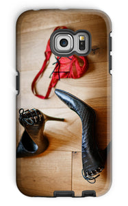 phone case showing pair of red knickers abandoned on wooden floor next to pair of black high heeled ladies shoes