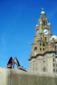 Liverpool liver building with pair of multi-coloured high heeled shoes in foreground