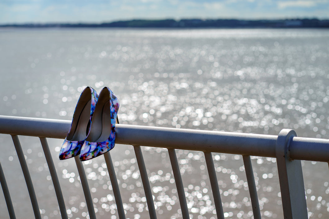 Women's shoes on the railings beside the River Mersey