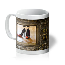 Load image into Gallery viewer, Tea or Coffee mug showing reflection in a mirror of pair of orange tipped black ladies high heeled shoes