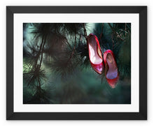 Load image into Gallery viewer, Framed print with black border of pair of ruby coloured ladies high heeled shoes hung from branch of a green mistletoe tree
