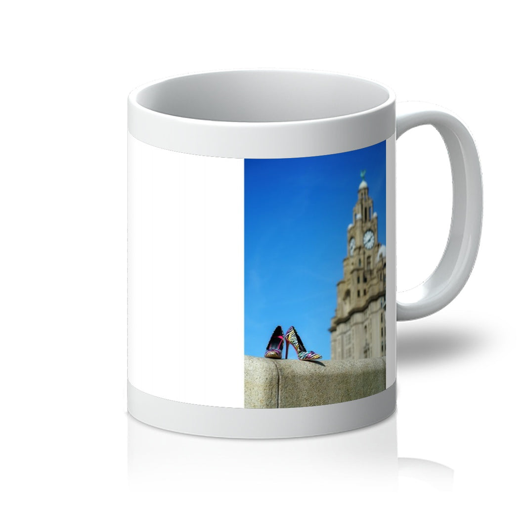 Tea or Coffee mug showing Liverpool liver building with pair of multi-coloured high heeled shoes in foreground
