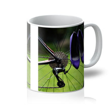 Load image into Gallery viewer, Tea or Coffee mug showing pair of purple high heeled ladies shoes hanging of spokes of the rear wheel of a bicycle