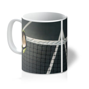 Tea or Coffee Mug showing Pair of women's high heeled shoes hanging over the top of a tennis net