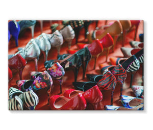canvas print of rows of women's high heel shoes on red floor