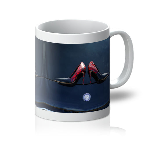 Tea or Coffee mug showing a pair of Ladies high heeled red and black shoes on bonnet of a black Mercedes-Benz car