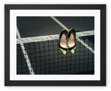 Load image into Gallery viewer, Framed print  with black border showing Pair of women's high heeled shoes hanging over the top of a tennis net