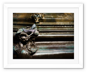 Framed print with white border showing womens shoes abandoned at a fountain