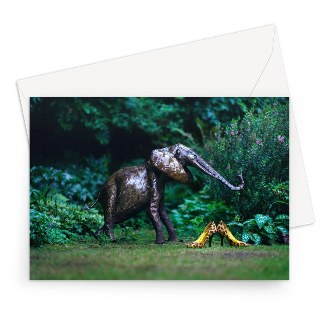 greeting card showing pair of leopard print ladies high heals shows, adjacent to a garden ornament of an elephant.