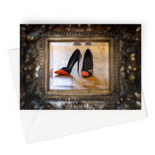 Load image into Gallery viewer, Greeting card of reflection in a mirror of pair of orange tipped black ladies high heeled shoes